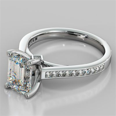 Emerald Cut Cathedral Style Engagement Ring With Princess Cut Accents