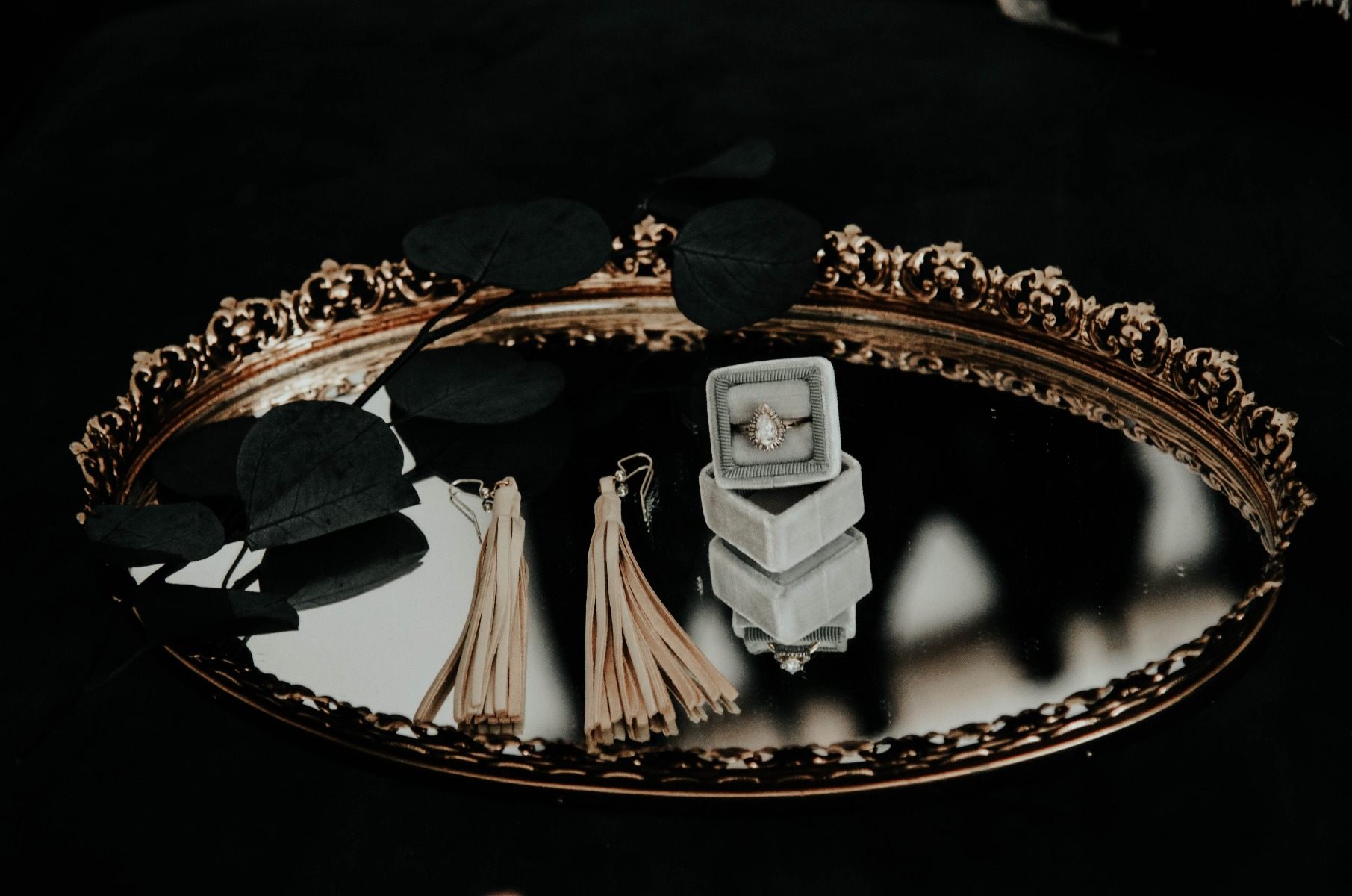 Engagement ring on a vanity mirror tray